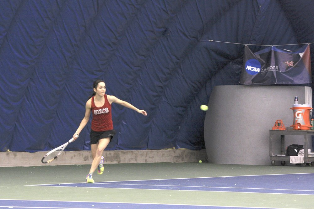 Sophomore Taylor Pena gets ready to hit the ball back to Linfield opponents_Jezierski_bright